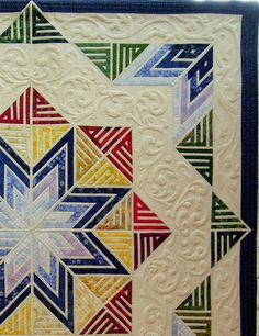 close up, Calligraphy Quilt by Layne Rahbar. Trapunto paisley quilting design.