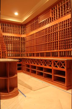 Wine racking systems constructed in Heart Redwood provided an exquisite look to this custom wine cellar in Los Angeles California. Coastal Custom Wine Cellars 26222 Paseo Toscana San Juan Capistrano, CA California Office: Wine Rack Design, Wine Cellar Design, Connecticut, Wine House, Los Angeles Homes, Wine Storage, Wine Cellars, House Design, Cellar Ideas