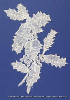 Honiton (East Devon) lace sprig - This holly motif is one of a series of naturalistic sprigs said to have been designed and made by Louisa Tucker, a daughter of the Branscombe lace manufacturer John Tucker. These finely made pieces are naturalistic representations of wild and garden plants. They were made on a lace pillow using bobbins wound with fine cotton threads. The holly berries are raised with a single purl at each point. The berries are raised and worked in half-stitch. John Tucker, The Royal Collection, Holly Berries, Lace Making, Bobbin Lace, Lace Weddings, Lace Design, Cotton Thread, Garden Plants