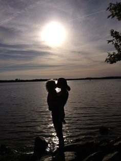 Silhouette of mother holding toddler (: <3