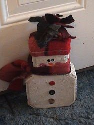 Snowman Doorstop-    1 block   White exterior paint   Acrylic paint colors, orange, pink, black   Fleece material (any color or design)   Misc. Buttons   Hot glue gun