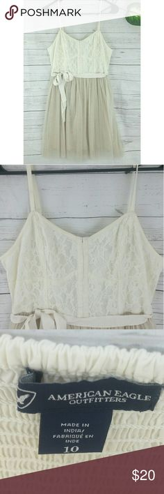 AEO dress NWOT size 10 summer sheer ivory Size 10 Adjustable lingerie straps and elastic back for perfect fit. Skirt is solid with a sheer layer over Removable ribbon at waist American Eagle Outfitters Dresses