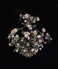 <b>LUSTRE DE STYLE LOUIS XV</b>  <br /> En bronze ciselé et doré, fleurs en porcelaine tendre du XXe siècle, à six bras de lumière <br /> H. : 60 cm (23  1/2 in.) <br /> D. : 53 cm (20  3/4 in.) <br />  <br /> A Louis XV style gilt-bronze and soft-paste porcelain six-light chandelier <br />  <br /> <br />  <br />  <br />