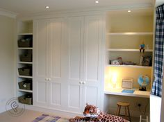 childrens shaker style fitted wardrobe with shelving and desk