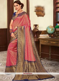 Rose Pink banarasi silk saree with navy blue silk blouse.Embellished with Woven Zari Work. Saree with Broad border ,Sweetheart Neckline, Short Sleeve. It comes with unstitch blouse, underskirt. Designer Silk Sarees, Latest Designer Sarees, Wedding Saree Collection, Saree Wedding, Wedding Dress, Wedding Wear, Indian Clothes Online, Kids Frocks Design, Blue Saree