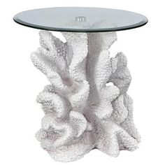A clear, tempered glass with a beveled edge tabletop is held up by a realistic resin coral reef replica. Accent Pieces, Glass, Table, Furniture, Home Decor, Decoration Home, Drinkware, Room Decor, Corning Glass