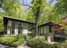 """This amazing home was the personal residence of Architect Jack C. Cohen. The 5 bedroom/4.5 bathroom 4,650 square foot home is nestled into the trees on a .81 acre corner lot and stands as a perfect example of what the phrase """"Mid Century"""" really is."""