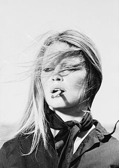 """""""A photograph can be an instant of life captured for eternity that will never cease looking back at you.""""  Brigitte Bardot"""