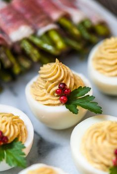 These merry little Christmas deviled eggs are so cute, festive, and incredibly tasty! All you need are a few pink pepper corns and a few parsley leaves to make these jolly appetizers. Holiday Appetizers Christmas Parties, Easy Christmas Dinner, Christmas Party Food, Xmas Food, Christmas Treats, Merry Christmas, Best Christmas Dinner Recipes, Elegant Christmas, Best Appetizers