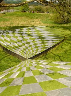 Charles Jencks Garden of Cosmic Speculation and outside art- Why cosmic? The shapes that are included in the garden represent those we can find the cosmos.