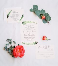 wedding invitation with red flowers