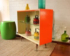 """Vintage Display Cabinet - updated with glossy paint. I like these cabinets for their """"airiness"""" as opposed to today's heavy, rustic-inspired furnishings."""