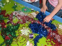 This gave me the idea to do a Christmas tree sensory table. I could put a small tree in each table and let the kids play with decorating it.