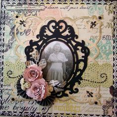 Lovely cut-work photo framing, studded scrolls and dimensional flowers give this page a feminine, vintage look.