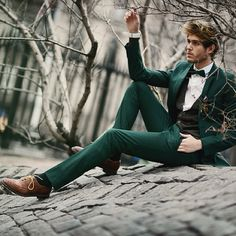 forest green suit and bow tie