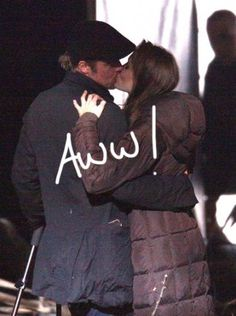 brad pitt shares a kiss with angelina jolie on the set of her new movie in budapest