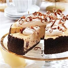 Marbled Cappuccino Fudge Cheesecake Recipe -I came up with this recipe because I love the frozen cappuccino drinks at coffee shops and wanted a cheesecake with the same goods. If you try it, don't hold the whip. The creamy mocha-infused topping is the best part! —Becky McClaflin, Blanchard, Oklahoma