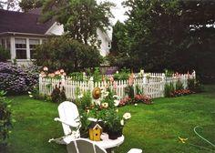 I love the idea of a white picket fence around a veggie garden