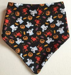 This is a cool handmade bib featuring a spooky ghost, devil, pumpkin & candy print on black with black towelling.  Would make a great baby shower gift, a thoughtful pressie to spoil a mum to be or just keep them for your little one. The bib is thick and absorbent so perfect for keeping little ones dry, clean and stylish.  Made with soft cotton and backed with terry towelling.  Dimensions: 30 X 20cm approx  Machine washable and iron on printed side. Pattern placement may differ slightly from…