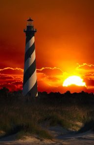 Cape Hatteras Light is a lighthouse located on Hatteras Island in the Outer Banks in the town of Buxton, North Carolina. I love lighthouses too. They remind me of the song about Jesus being our Lighthouse! Saint Mathieu, Cape Hatteras Lighthouse, Lighthouse Pictures, Lighthouse Art, Am Meer, Beautiful Sunrise, Sunset Beach, Red Sunset, Wyoming