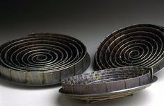 Jane Adam - spiral brooches in oxidised silver, dyed anodised aluminium and 9ct gold wire   Av. size 60x60mm  2003