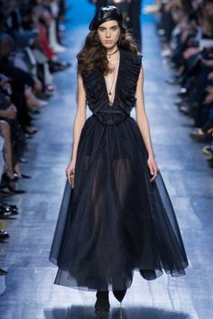 Maria Grazia Chiuri focused on blue hues for Dior's spring-summer 2017 collection presented during Paris Fashion Week. The Italian designer sent out military chic inspired looks complete with berets, studded cross body bags and choker necklaces. Also offered up on the runway? Denim pieces including jumpsuits, jackets and relaxed-fit pants. For evening wear, the Dior …