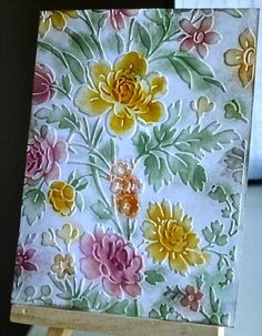 floral BG color with distress inks on raised dry embossed card by Harriet Skelly