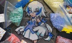 The pokemon Lugia, in moemon form made from an assortment of perler beads.