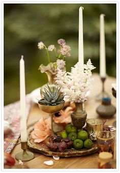 Flowers / Table: Fruit & succulents as centerpieces. Tall tapers in old brass candlesticks