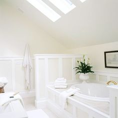 Elegant Bath in the attic, and making use of skylights.