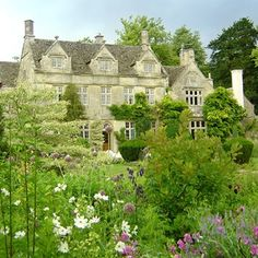 Barnsley House, Cirencester, Glocs. The '1697' & 'BB' carved into the Cotswold stone mark the date Brereton Bouchier, Barnsley village's squire, built the property. In 1952, architectural historian David Verey & his wife Rosemary, bought the house. As keen gardeners, both spent many hours transforming the grounds into a place that enjoys international acclaim for its beauty. Rosemary passed away in 2001 & her son, Charles, took care of the property, until purchased to be a Cotswolds hotel.