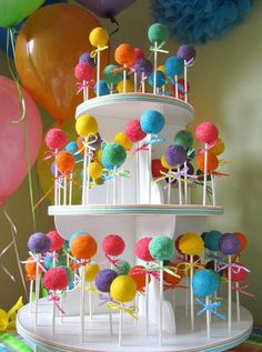 coloured cake pops on cupcake stand <3