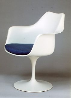 "Designer: Eero Saarinen Piece: ""Tulip"" Armchair (Model No. 150) Manufacturer: Knoll Date: 1956 Medium: Aluminum, plastic, wool and nylon upholstery Dimensions: H. 35-3/4, W. 61-1/2 inches (90.8 x 156.2 cm.) Seat H. 18 inches (45.7 cm.)"