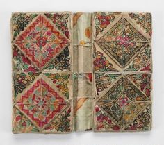 """Embroidery and Thread Case, Artist Unknown (Miao) 25.08 x 15.24 x 3.18 cm fabric covered multi-pocket folding thread container; front cover is printed fabric, printed with the words, """"fragrant MEMORIES""""; fabric covers on small inner pockets, painted (?); eleven compartments in all--largest (center) compartment contains multicol"""