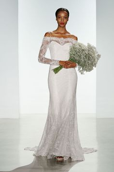 Just because you want a long-sleeved wedding dress, doesn't mean that you can't bare those stunning shoulders! These gorgeous lacy sleeves and illusion neckline are layered over a simple spaghetti-strap dress.