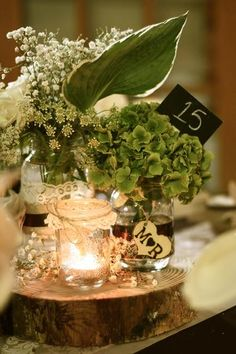 Mixing and matching lace, burlap and ribbon on the jars this could work with the 3 jars for the centerpiece! Centerpieces by Simply Surreal