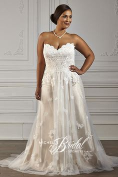 Michelle Bridal by Sydney's Closet MB1607  Michelle Bridal Prom, Bridal, Bridesmaid, Pageant, & Special Occasion Gowns- WWW.PROMUSA.BIZ   Vintage inspired plus size wedding gown for the bride who wants a romantic nod to the past. Chorded Chantilly lace covers the strapless bodice and lace-up corset back. Matching lace appliques drizzle down the soft tulle net skirt designed in a flattering A-line silhouette. Ivory lace over champagne satin create a stunning but subtle contrast.