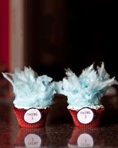 Dr. Seuss cupcakes! Red Velvet cake mix, white frosting, and blue cotton candy! What a great idea!!