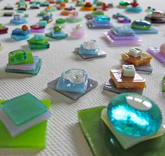 tiny little stacks of glass waiting to be cleaning and then carefully placed in the kiln for fusing ..