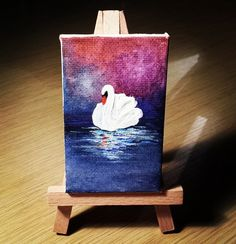 Tiny painting of a swan, by Caterina Bassano. Acrylic on mini canvas 8 x 5 cm