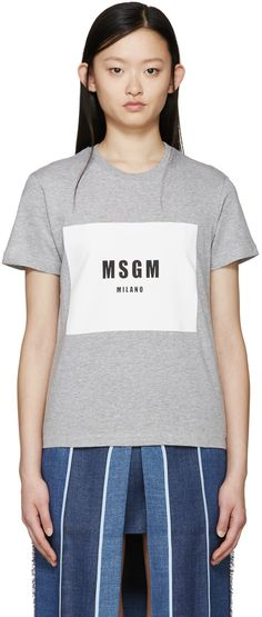Short sleeve t-shirt in heather grey. Rib knit crewneck collar. Logo printed at front in white and black. Tonal stitching.