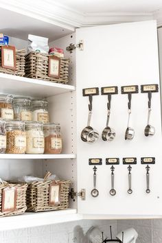 Pantry Cabinet Organization and Free Printable Label Set | blesserhouse.com - A cabinet gets a drastic organization makeover using inexpensive IKEA jars / baskets, hanging storage, and a free pantry label printable set. #organization #printables