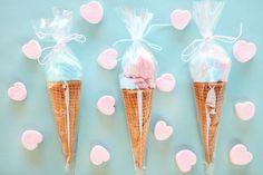 Cotton candy in sugar cones.