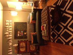 sofa. cabinet. ottoman. rug. side table. bigger toss pillows. throw.