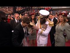 Sacha Baron Cohen The Dictator Spills Kim Jong Il's 'Ashes' On Ryan Seacrest Sacha Baron Cohen, Oscars 2012, Kim Jong Il, Ryan Seacrest, Embarrassing Moments, Latest Celebrity News, Upcoming Movies, Live Tv, Popular Culture