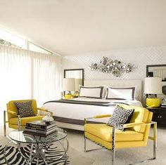 Modern Chic bedroom in gray and yellow in addition to black and white make a harmonious flowing bedroom. They used just the right amount of yellow to create interest and not over power the room. I love the tone on tone wallpaper, and of course I am always a fan of a little zebra print.