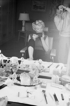 Marilyn doing her make-up, Los Angeles, 1954. Photo by Milton Greene.