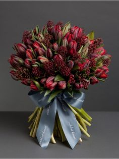 Pretty Spring wedding bouquet with red tulips.