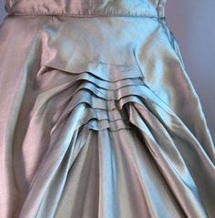 A series of horizontal tucks adds interest to the full skirt on this 1950s party dress.