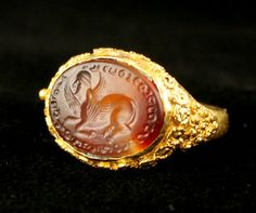 Parthian Gold Ring with a Carnelian Intaglio. I think this was used as a seal for wax.